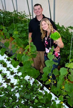 Ryan and Katie Chatterson survey aquaponic beds at Chatterson Farms.
