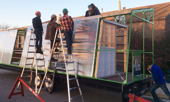 Ball State architecture students building the GrOwING GREEN mobile greenhouse. Photo credit: Timothy Gray.