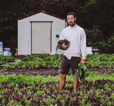 Michael Meier, co-founder and head farmer at Ground Floor Farm in Stuart, Florida. Photo credit: Zoe Aparicio.