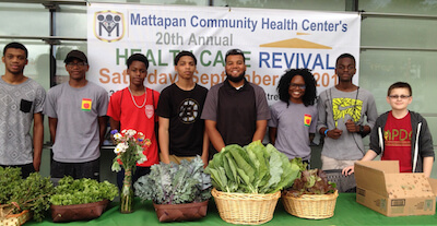 Shavel'le Olivier (in glasses), leader of the Mattapan Food and Fitness Coalition Vigorous Youth with the group's Mobile Market team. (Photo courtesy of Mattapan Food and Fitness Coalition)