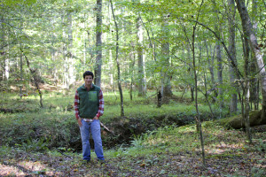 Rick Bagel, developer of Wetrock Farm in Durham, North Carolina, stands in the middle of preserve forest in his new development. (photo courtesy of Rick Bagel/Wetrock Resources, LLC)