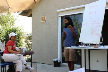Rishi Kumar, co-founder of The Growing Club, teaching a class. Photo courtesy of The Growing Club.