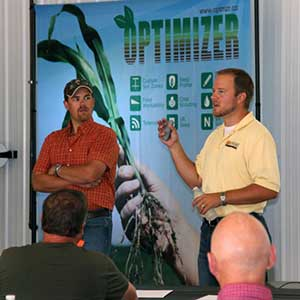 Daryl Starr (right) shares Optimizer with local farmers. Photo courtesy of Advanced Ag Solutions