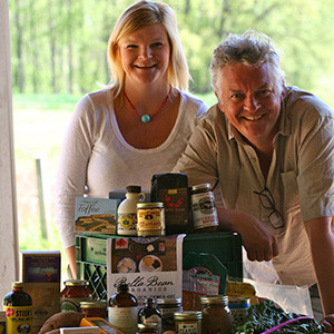 Richard Holcomb and Jamie DeMent, co-owners of Bella Bean Organics, are shown with products from Bella Bean Organics and Coon Rock Farm. Photo courtesy of Cheryl DeMent