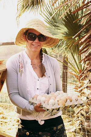 Sasha Kanno, president of and farmer at Long Beach Local, holds eggs that came from her farm. (photo courtesy of Sasha Kanno)