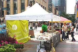 Homegrown Minneapolis has developed a brand that was used at the Nicollet Mall Farmers market to advertise locally produced and processed products. Image credit: Jane Shey
