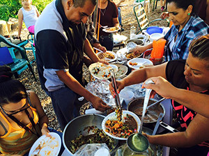 A feast is enjoyed at Huerta Del Valle Community Garden in San Bernardino County. (photo courtesy of Arthur Levine/Huerta Del Valle)