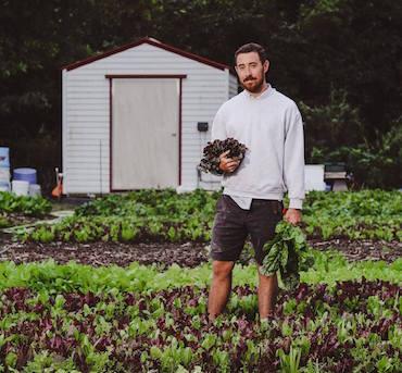 Michael Meier, co-founder and head farmer at Ground Floor Farm in Stuart, Florida. Photo credit: Zoe Aparicio.