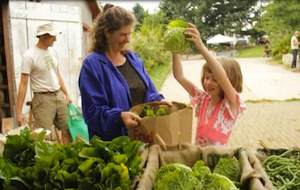 Members of Zenger Farm Shares Community Supported Agriculture program pick up their produce at the farm, courtesy Zenger Farm.