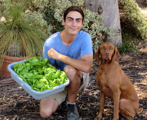 HIjazi at work with his dog. Courtesy of Sundial Farms