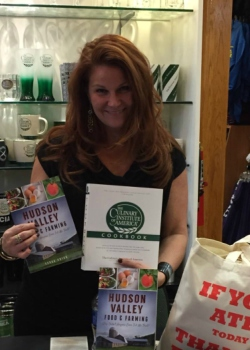 Tessa Edick posing with a copy of her book on the Hudson Valley food system. Edick is the Executive Director of the FarmOn! Foundation, which raises capital to support a variety of food system-building projects in New York's Hudson Valley. Photo courtesy of FarmOn! Foundation.