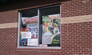 Among promotional materials for donuts and carbonated beverages, Fresh Corner Café advertises its healthy food offerings at a Detroit corner store. (photo courtesy of Noam Kimelman/Fresh Corner Café)