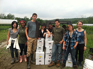 Volunteers pose next to boxes of gleaned food, all destined for a Vermont food hub. Numerous food hubs in the state supply produce to schools. (photo courtesy Abbey Willard/Vermont Agency of Agriculture, Food and Markets)