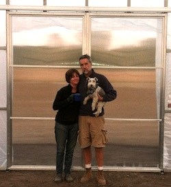 Lisa Jaroch of Cold Frame Farm and her husband in front of their cold frame hoop house.