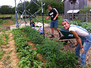 """Students at the Merry Lea sustainable farm in Indiana are seen working at the """"kitchen farm"""". (photo courtesy of Jon Zirkle/Merry Lea Environmental Learning Center)"""
