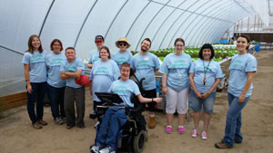 A group of clients is pictured inside the Growing Opportunities greenhouse. Through working in the hydroponic greenhouse over the course of 20 weeks, the low-income and/or disabled clients gain skills and confidence to enter the work world. (photo courtesy Nicole Wooten/Growing Opportunities)